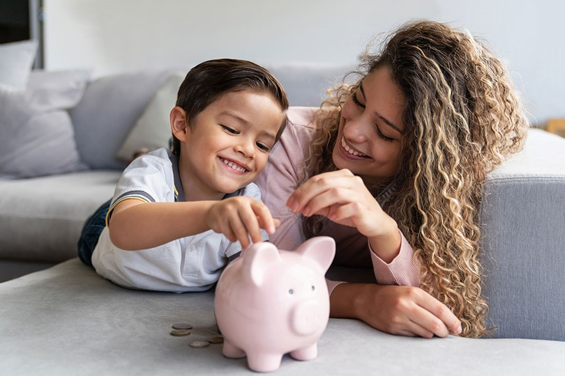 Woman And Boy With Piggy Bank (1)