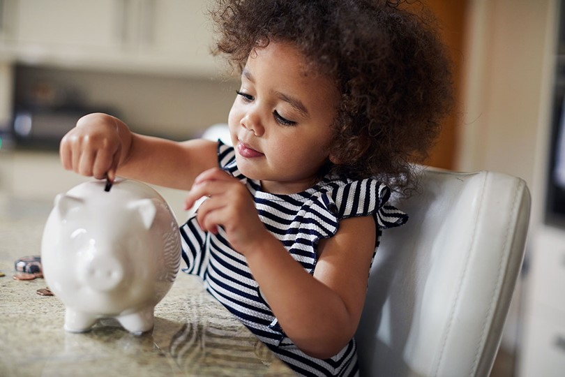 Child With Piggy Bank (1)